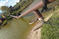 bented_pipe_on_river